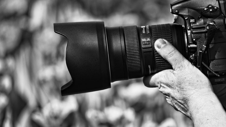 camera man holding nikon